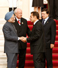 President Sarkozy welcoming Prime Minister Dr Manmohan Singh with Messrs Barroso and Jean Claude Gaudin, senator and mayor of Marseille