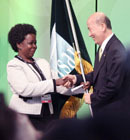 Lee Maanee, Minister of Environment, Republic of Korea, received the Ramsar flag from Maria Mutagamba, Minister of Water and Environment, Uganda