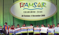 Children from the 10 countries which have hosted Ramsar COPs presented the message of COP 10.