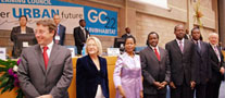 Delegates stand to congratulate students of the Youth Empowerment Programme. L-R: Achim Steiner, Executive Director, UNEP; Inga Bjork-Klevby , Deputy Executive Director, UN-HABITAT; Anna Tibaijuka, Executive Director, UN-HABITAT; Stephen Kalonzo Musyoka, Vice President, Kenya; Soita Shitanda, Minister for Housing, Kenya; Michael Werikhe, Minister of Lands, Housing, and Urban Development, Uganda; and Rolf Wichmann, Secretary, UN-HABITAT Governing Council.