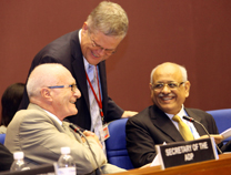 ADP Co-Chairs Harald Dovland, Norway, and Jayant Moreshwar Mauskar, India, being congratulated by Haldor Thorgeirsson, UNFCCC Secretariat at the close of AWG-ADP.